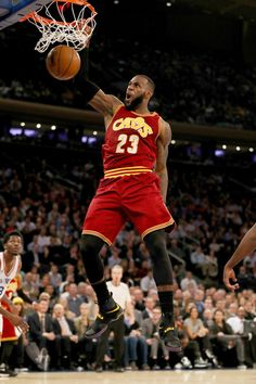 LeBron James Photos Photos - LeBron James #23 of the Cleveland Cavaliers dunks in the second quarter against the New York Knicks at Madison Square Garden on December 7, 2016 in New York City. NOTE TO USER: User expressly acknowledges and agrees that, by downloading and or using this Photograph, user is consenting to the terms and conditions of the Getty Images License Agreement - Cleveland Cavaliers v New York Knicks