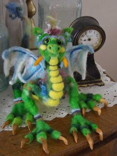 Diana Geis Wins a $25 Gift Certificate! Diana submitted her wonderful dragon for our felted fairy fantasy week! He just makes you smile!