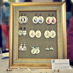 I HAVE THIS OVER MY DRESSING TABLE ..DIY :picture frame earring display