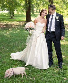 Pig on a Leash Bridal Portrait | 8 Cute Animal Wedding Photos | https://www.theknot.com/content/cute-animal-wedding-photos