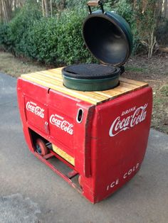 Big Green Egg table made from a vintage Coca-Cola cooler.