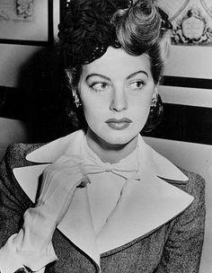 Ava Gardner- Sundi Pearson  Downtown Shoot  White Bowtie, interesting hair piece, White gloves, exaggerated collar blazer