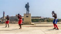 Cuba boxers — Cuban boxers spar on the Malecon in front of the statue of Francisco de Miranda, a Venezuelan revolutionary considered the forefather of the Latin American independence movement.