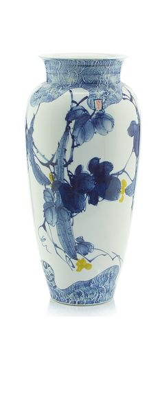 "A blue, white and yellow gallery sized tall porcelain vase glazed with a gourd and bird motif. Features: - Finish: Blue, White and Yellow Measurements: 21"" h x 10"" d"