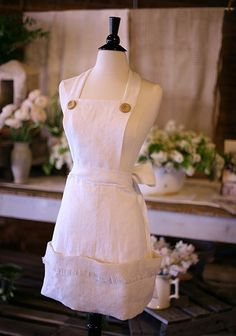 White linen apron with wood buttons