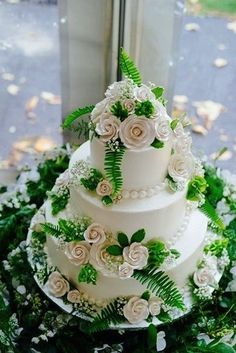 Add faux ferns to your wedding cake for an inexpensive alternative.  Customer Submission.  Find more DIY Design Ideas at Afloral.com