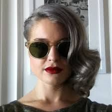 Grey swept hair and wine red lip.