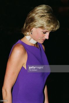 Diana, Princess Of Wales, Looking Pensive As She Leaves A Gala Dinner Held At The Field Museum Of Natural History. The Princess Is Wearing A Purple Evening Dress Designed By Versace.