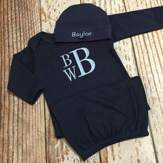 Bring your little one home in this adorable monogrammed cap and gown combo.  Makes a great baby shower gift or outfit for newborn pictures. Gowns are