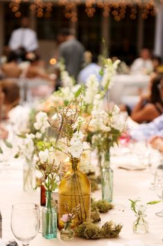 Every guest makes their own flower bouquet and puts it in a colorful jar at their table seat