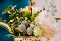1950s Wedding Ideas | Confetti Daydreams - A floral mix guided by the color palette of peach, teal, white and gray, i like the pussy willow looking things