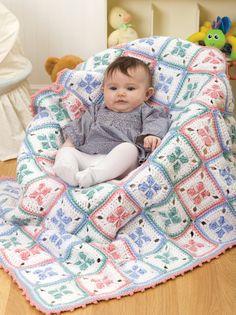 Realiza esta linda cobija para mantener abrigado a tu bebé, con estambre Super Saver podrás avanzar rápidamente en el tejido.