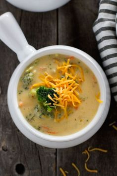 A creamy, cozy broccoli cheese soup that's loaded with cheddar cheese, broccoli and carrots. This broccoli cheese soup is better than Panera Breads version!