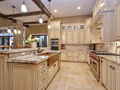 Traditional Kitchen with Farmhouse sink, Pendant light, High ceiling, Flat panel cabinets, Columns, Herringbone Tile, Flush
