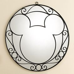 Used Disney Mickey Mouse Wrought Iron Round Mirror. First picture shows the condition of the mirror and second picture shows where it gets hung by.