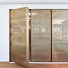Loving this door-like beverage storage solution in perforated brass. Design by…