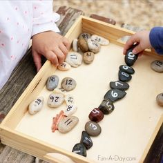 Simple number rocks can be taken outside for fun preschool number activities