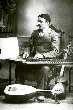 Azerbaijani musician Meshadi Jamil Amirov playing qanun, Elizabethpol (today Ganja), 1915