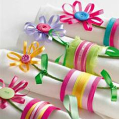 Make napkin holders by using oddments of ribbon for your party table