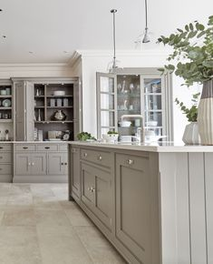 The Marjoram painted island in this Hartford kitchen is the perfect central feat. The Marjoram painted island in this Hartford kitchen is the perfect central feature to host guests this winter. The proportions and… Grey Shaker Kitchen, Shaker Style Kitchens, Grey Kitchen Cabinets, Built In Cabinets, Painting Kitchen Cabinets, Kitchen Flooring, New Kitchen, Home Kitchens, Island Kitchen