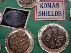 Prep Unit or Unit 1 ... Roman Shield Activity-Paper Plate Education - paper plate, draw image and trace with hot glue, cover in foil and rub thin coat of shoe polish over. Add handle if desired.