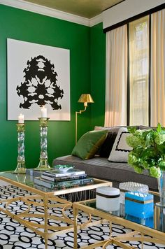 Dripping painted Emerald Green and  Gold leaf over light gray accent wall. dolphin gray side walls Black and white photos.  Some with pops of bright yellow and touch of pink White bookcase with green shelves Green door If I'm aloud...