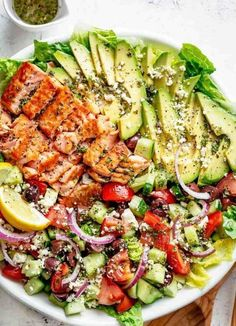 Avocado salmon salad with an incredible lemon and herb Mediterranean dressing . - Avocado salmon salad with an incredible lemon and herb Mediterranean dressing! Salmon Salad Recipes, Taco Salad Recipes, Seafood Recipes, Fish Recipes, Grilled Salmon Salad, Salmon Salad Sandwich, Health Salad Recipes, Vegetarian Taco Salad, Feta