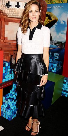 Last Night's Look: Love It or Leave It? Vote Now! | MICHELLE MONAGHAN | in a perforated collared T-shirt paired with a midi-length tiered leather skirt (both Erdem) and black heels at the Pixels premiere in N.Y.C.
