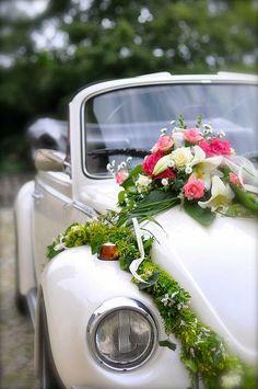 Floral arrangement for wedding car