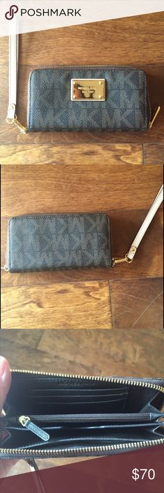 """MK signature brown/tan wristlet w/ gold hardware Authentic. Excellent condition. Brand new without tags. Comes with box. Measures 6.75"""" x 3.5"""" x 1"""" Michael Kors Bags Clutches & Wristlets"""