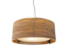 Scrap Lights are pendant lamps laser-cut from repurposed cardboard boxes, hand assembled in Seattle.