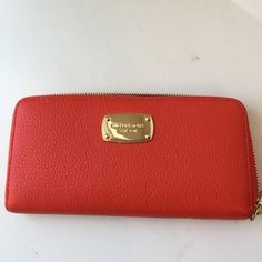 MICHAEL Michael Kors jet set mandarin wallet Mandarin Pebble leather with gold zipper and logo. In perfect condition. No stains, no scratches, no holes. Holds over 8 credit cards plus change purse section. No TRADES! PRICE FIRM unless bundled! MICHAEL Michael Kors Bags Wallets