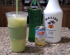 scooby snack drink with midori, coconut rum and pineapple juice