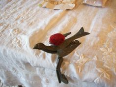 Lovely antique sewing bird with red velvet by TheVelvetValet