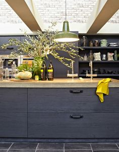 Industrial black kitchen with natural stone counters