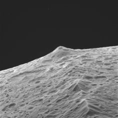 The mountains along Iapetus' equator reach heights of up to 12 miles (20 kilometers). Credit:  NASA/JPL/Space Science Institute