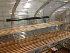 Sunglo greenhouse cedar shelves and benches. Custom layouts available. Contact us today for more info www.facebook.com/sunglo.greenhouse
