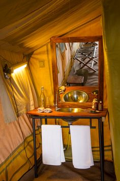 You know you are glamping when you have a sink in your tent... See more:- http://www.sanctuaryretreats.com/tanzania-camps-ngorongoro-crater-camp