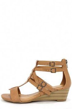 02c045dd0b1f The City Classified Lativ Tan Strappy Wedge Sandals have a fashionable T  strap upper with crisscrossing belted accents and pewter buckles that  adjust to ...