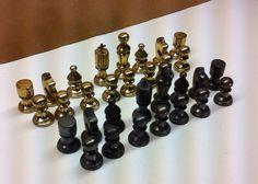 Brass vtg italian chess pieces.