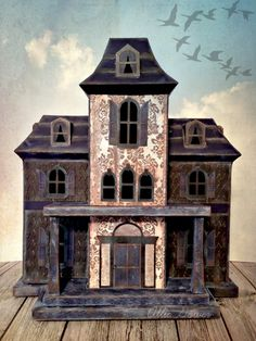 Blue skies, birds flying high, Allie's Manor standing the test of time! From the ink-stained pillars to the embossed siding, Allie's haunted house is Spooktacular! Fabulous job! Allie also gives a tip we all should follow- The trick to a large piece like this is to take your time, and really make sure each piece is well glued before moving on. This is so true! Great advice, Allie! You can find this awesome file in MAPLE MANOR SVG KIT!