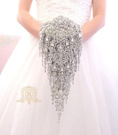 Check out this item in my Etsy shop https://www.etsy.com/listing/203122581/extra-long-brooch-bouquet-teardrop