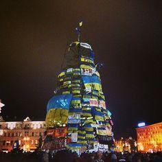 Ukraine: Kyiv's Christmas tree is replaced with Ukrainian flags during rallies. December 2013.