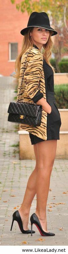 Animal print cardigan and all black @}-,-;--
