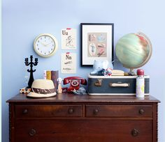 Suitcase, globe, red phone and wonderful prints on the wall? Yes please!