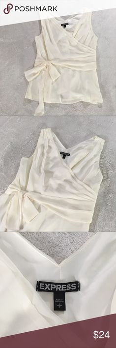 Sleeveless top by Express - Size Small Beautiful short sleeve shirt by Express- size small neutral tone, slightly off whitish color. Photos on white blanket. Zips on side. Express Tops