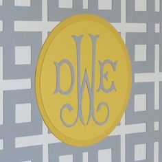 Again, I like the color blocking here...paper monogram on canvas