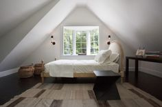 Pitched ceiling, attic bedroom, white, light, good angles.