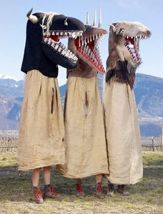"""The Schnappviecher of the Tyrol region of Italy, whose name means """"snapping beasts,"""" and appear on Shrove Tuesday during Holy Week, just before Easter. The origins of this tradition are shrouded in mystery, but people seem to love it anyway! These costumes can reach up to nine feet in height, too."""