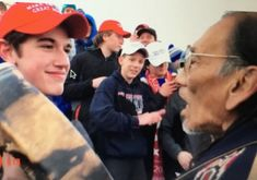 US Catholic school faces outcry after students mock Native American veteran Catholic High, Catholic School, Native American Men, Baseball Caps, High School Students, Drums, Nativity, Donald Trump, Face